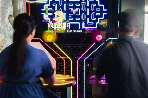 Two people on the Pacman game